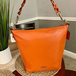 Brand new, orange Coach bag